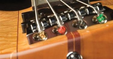 how to fix a bowed guitar neck without a truss rod